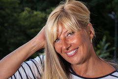 Beautiful Mature Woman Holding Her Hair. Close up Royalty Free Stock Image