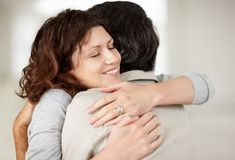 Beautiful mature woman hugging her husband Royalty Free Stock Photo