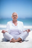 Beautiful mature woman meditating Stock Photo
