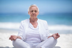 Beautiful mature woman meditating Royalty Free Stock Photos