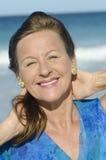 Beautiful mature woman  ocean Stock Images