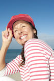 Beautiful mature woman ocean background Stock Images