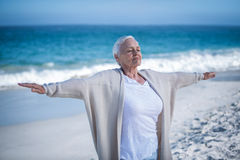 Beautiful mature woman outstretching arms Stock Photography