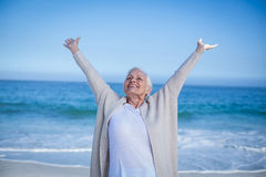 Beautiful mature woman outstretching arms Stock Images
