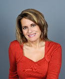 Beautiful Mature Woman. Portrait of a Beautiful Mature Woman wearing a Red Sweater Royalty Free Stock Photo
