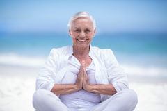 Beautiful mature woman posing with hands joined Royalty Free Stock Photography