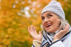 Beautiful mature woman. Posing outdoors in autumn stock photos