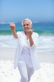 Beautiful mature woman practicing fighting sport Royalty Free Stock Photography