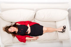 Beautiful mature woman relaxing on the sofa at home Royalty Free Stock Images