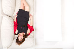 Beautiful mature woman relaxing on the sofa Royalty Free Stock Photography