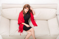 Beautiful mature woman on the sofa at home Stock Images