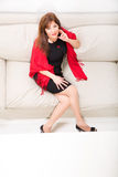 Beautiful mature woman on the sofa at home Royalty Free Stock Photos