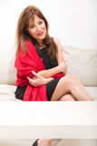 Beautiful mature woman on the sofa at home Royalty Free Stock Image
