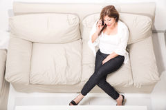 A beautiful mature woman talking on her cell phone Stock Photos