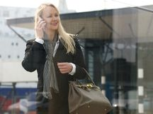 Beautiful mature woman talking on mobile phone outdoors Stock Photo