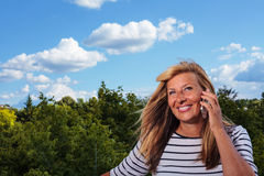 Beautiful Mature Woman Talking on the Phone Stock Image