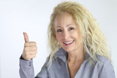 Beautiful mature woman thumb up Stock Images