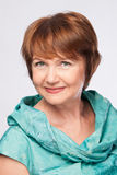 Beautiful mature woman in turquoise Stock Photo