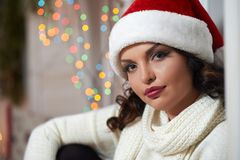 Beautiful mature woman wearing Christmas hat royalty free stock images