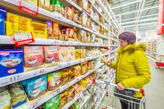 Beautiful mature women choose different goodies in a large shopping center. Russia Samara March 2019: beautiful mature women choose different goodies in a large stock photos