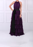 Beautiful mauve dress. Tall young woman wearing an elegant mauve dress with black bow Royalty Free Stock Photo