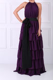 Beautiful mauve dress. Tall young woman wearing an elegant mauve dress with black bow Royalty Free Stock Photography