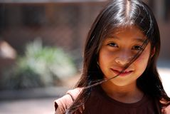 Beautiful Mayan Girl. 8 year old Mayan Girl with the wind blowing her hair in her face Stock Photos