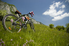 Beautiful meadow with bicycle and socks. Biking in Flax's Meadow in Postavaru Mountains, Romania Royalty Free Stock Images