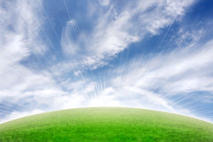 Beautiful meadow with sky and sun flare Stock Photography