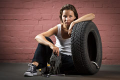Beautiful mechanic in auto repair shop Stock Photo
