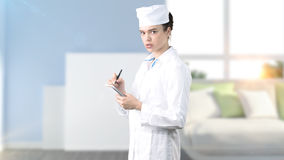 Beautiful medical woman doctor in uniform. Studio painted background. Concept of profitable health care. Royalty Free Stock Photo