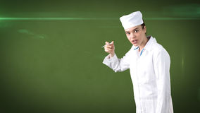 Beautiful medical woman doctor in uniform. Studio painted background. Concept of profitable health care. Stock Images