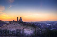 Beautiful Medieval castle ruin in countryside landscape during W. Stunning Winter sunrise landscape over frosty Medieval castle on hill in countryside Royalty Free Stock Image