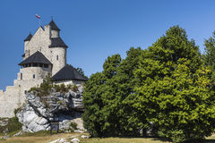 Beautiful medieval castle at sunny day over blue sky, Bobolice, Royalty Free Stock Images