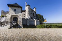 Beautiful medieval castle at sunny day over blue sky, Bobolice, Stock Image