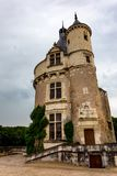 Tower of Chateau de Chenonceau on cloudy day. Beautiful medieval tower of Chateau de Chenonceau in Franceon cloudy day royalty free stock photos