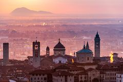 Beautiful medieval town at sunrise morning with main sights of Bergamo Lombardy from Castello di San Vigilio, Italy.  royalty free stock photography