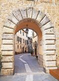 The beautiful medieval village of Sorano, Italy. The arched entrance to the narrow streets of the ancient medieval city of Sorano located in Tuscany, Italy Stock Photo