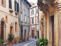 The beautiful medieval village of Sorano, Italy. The narrow streets of the ancient medieval city of Sorano located in Tuscany, Italy Stock Photo