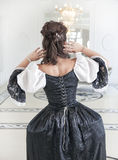 Beautiful medieval woman in black and white dress, back Stock Photos