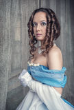 Beautiful medieval woman in blue dress Royalty Free Stock Images