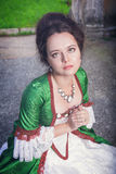 Beautiful medieval woman in green dress praying Royalty Free Stock Photos