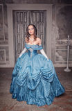 Beautiful medieval woman in long blue dress Stock Image