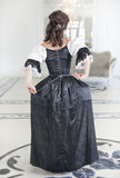 Beautiful medieval woman in long dress, back Stock Photo