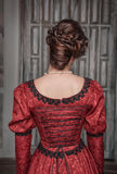 Beautiful medieval woman in red dress, back Royalty Free Stock Photos