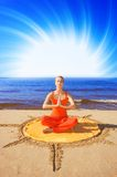 Beautiful meditating girl. On the beach Royalty Free Stock Image