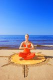 Beautiful meditating girl. On the beach Royalty Free Stock Photo