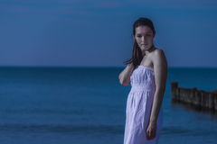 Beautiful meditative woman on a moonlit seashore Royalty Free Stock Photography