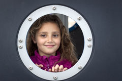 Girl looking out of hole Royalty Free Stock Images
