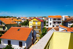Beautiful mediterranean cityscape. With orange houses  and blue sky, Croatia Stock Photography